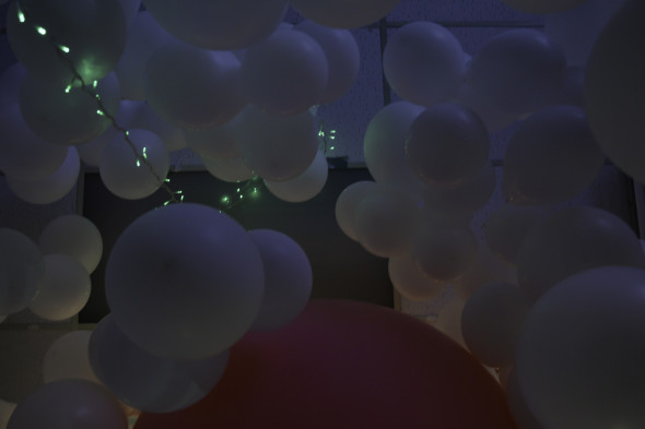 looking up into hope floats white balloons